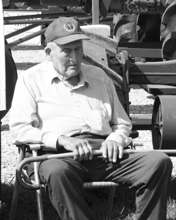 An Elderly Gentlemen Sitting By His Tracotr On A Hot Summer Day. Poster featuring the photograph Farmer by Ralph Hecht