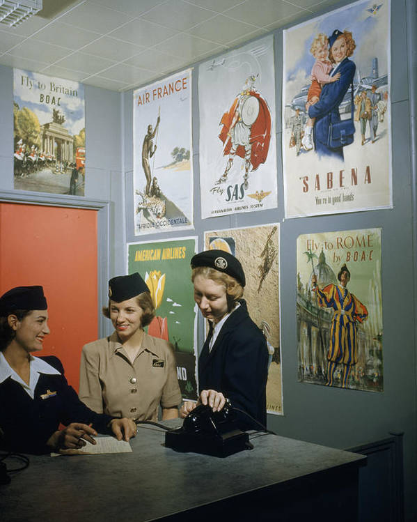 Indoors Poster featuring the photograph Flight Attendants Stand And Talk by B. Anthony Stewart