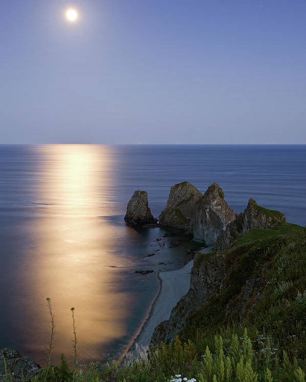 Vertical Poster featuring the photograph Full Moon On Cape Four Rocks by V. Serebryanskiy