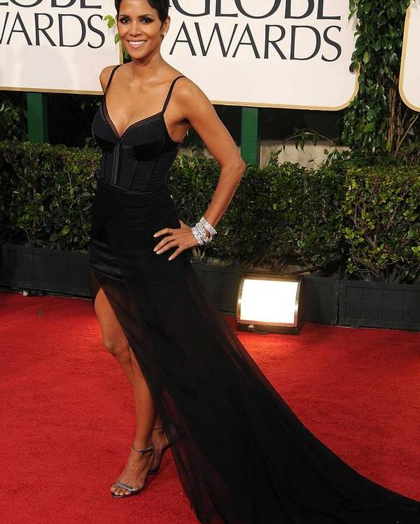 Halle Berry Poster featuring the photograph Halle Berry Wearing A Nina Ricci Gown by Everett