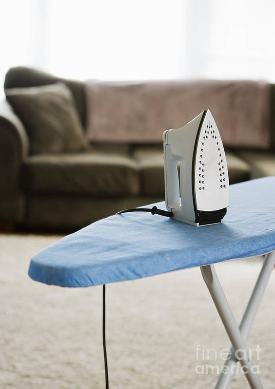 Appliance Poster featuring the photograph Iron On An Ironing Board by Ben Sandall