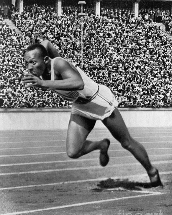 1936 Poster featuring the photograph Jesse Owens (1913-1980) by Granger