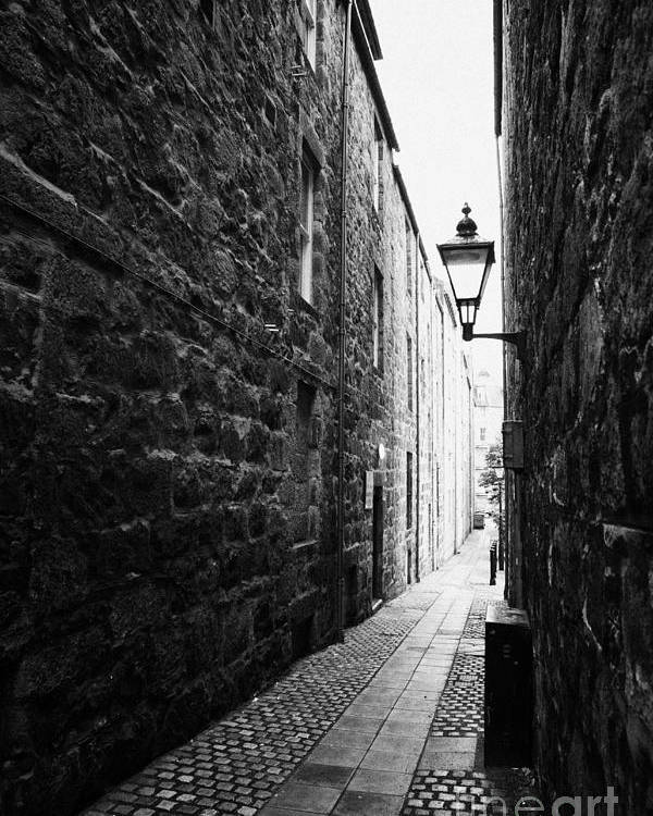 Martins Poster featuring the photograph Martins Lane Narrow Entrance To Tenement Buildings In Old Aberdeen Scotland Uk by Joe Fox