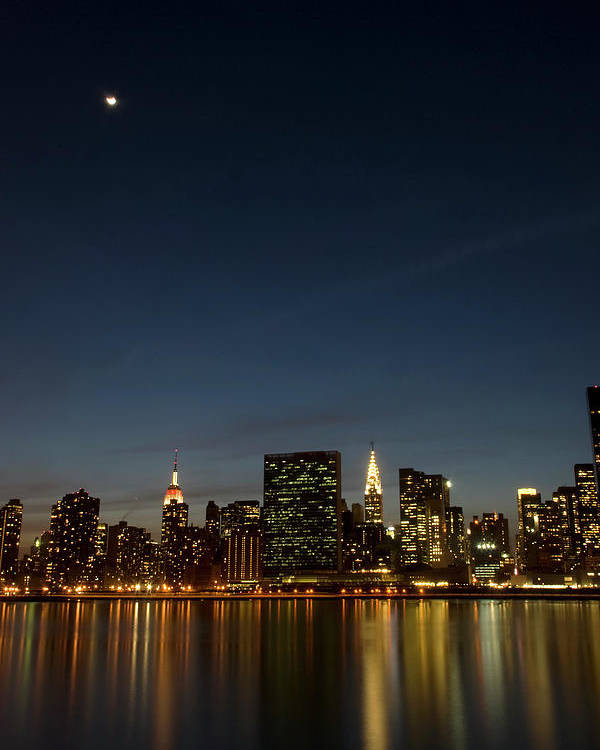 Vertical Poster featuring the photograph Moon Over Manhattan by Photographs by Vitaliy Piltser