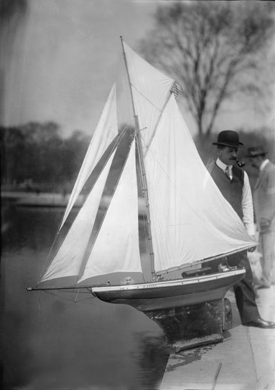 1910s Poster featuring the photograph New York City, Man With Toy Yacht by Everett