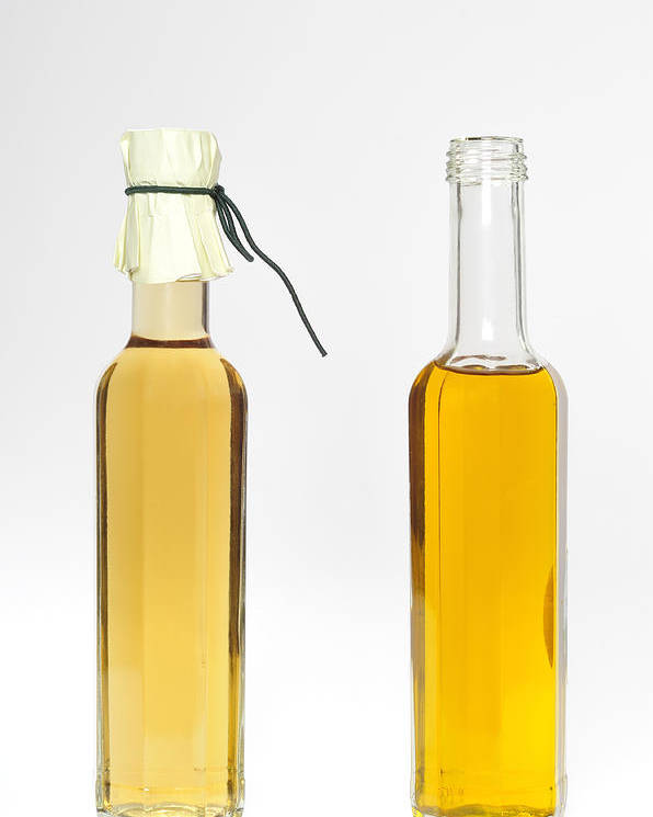 Balsamic Vinegar Poster featuring the photograph Oil And Vinegar Bottles by Matthias Hauser