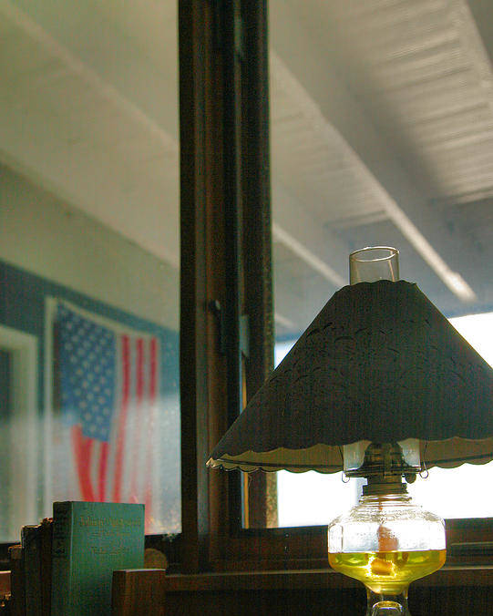 Light Poster featuring the photograph Oil Lamp And Porch by Steven Ainsworth