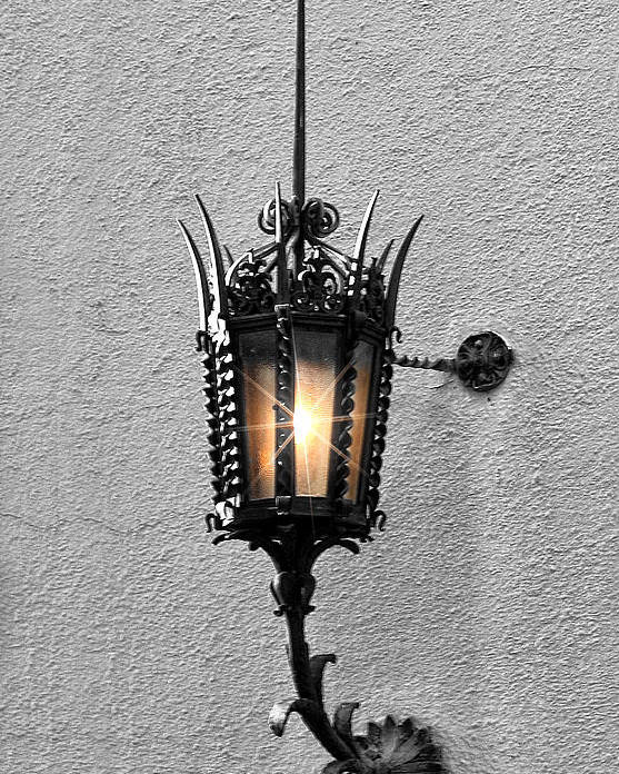 Lighting Poster featuring the photograph Outdoor Wall Lamp Aglow by Linda Phelps