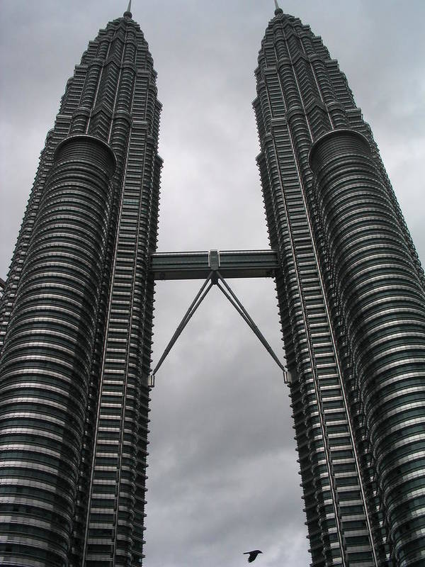 Malaysia Poster featuring the photograph Petros Towers Surreal by Robert M Brown II