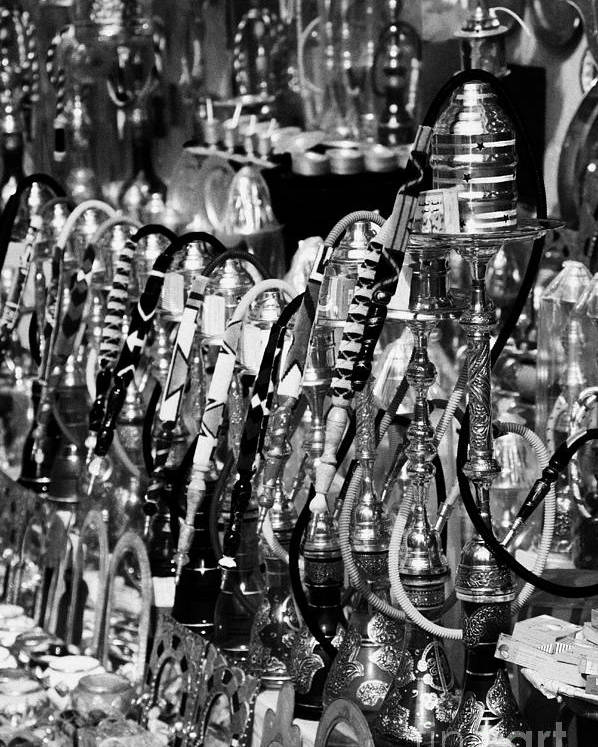 Tunisia Poster featuring the photograph Rows Of Metal Shisha Pipe Arabic Tobacco Smoking Water Pipes On A Stall In The Market In Nabeul by Joe Fox
