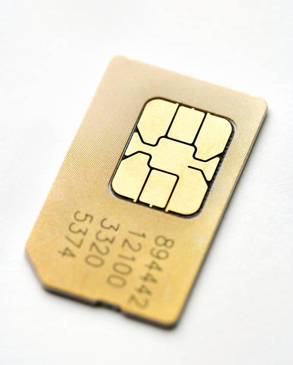 Sim Card Poster featuring the photograph Sim Card by Jon Stokes