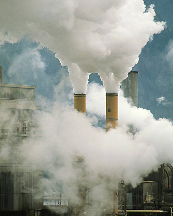 Chimney Poster featuring the photograph Smoking Chimneys Of A Paper Mill Polluting The Air by Kaj R. Svensson