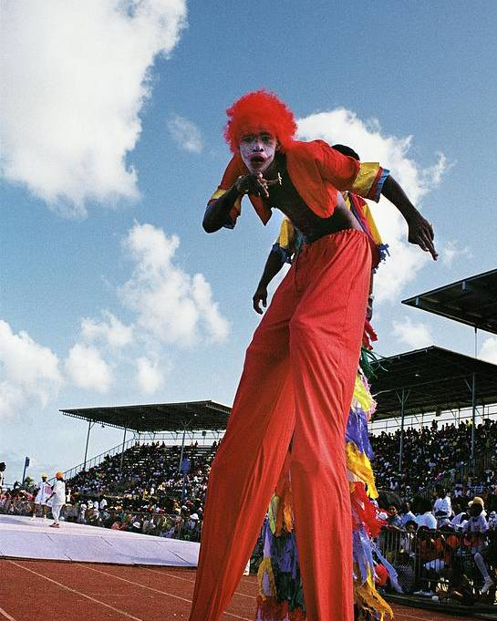 Barbados West-indies Caribbean Crop-over Annual Festival Carnival Stilt-man Stilt-walker National Stadium Colonial Practice Historical Culture Costume Poster featuring the photograph Stiltman by Ronald Griffith