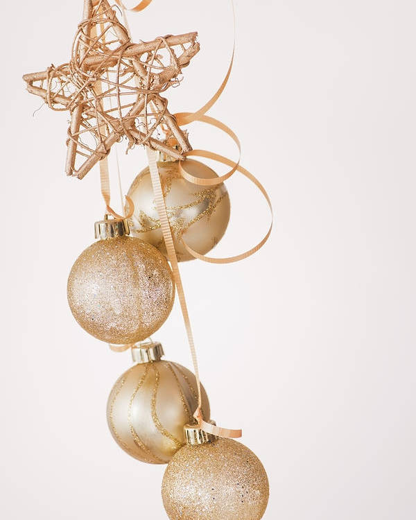 Vertical Poster featuring the photograph Studio Shot Of Gold Christmas Ornaments by Daniel Grill