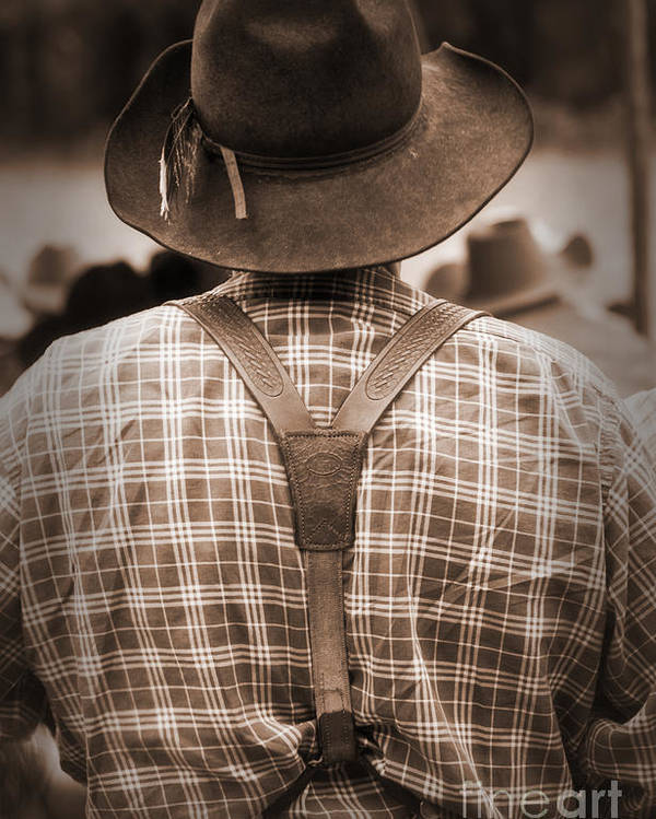 Cowboy Poster featuring the photograph Suspended by Fred Lassmann