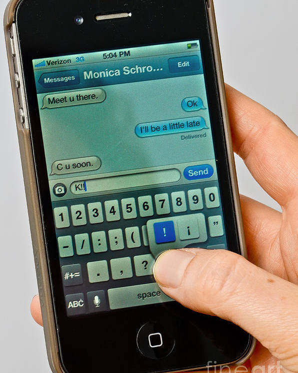 Sms Poster featuring the photograph Texting On An Iphone by Photo Researchers