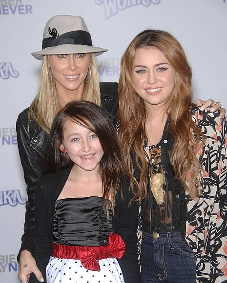 Tish Cyrus Poster featuring the photograph Tish Cyrus, Noah Cyrus, Miley Cyrus by Everett