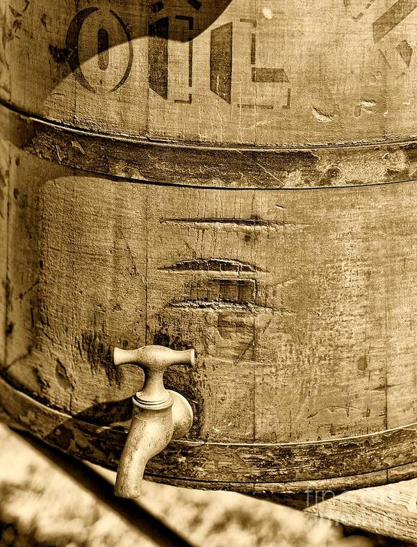 Weathered Red Oil Bucket Poster featuring the photograph Weathered Wooden Bucket In Sepia by Paul Ward