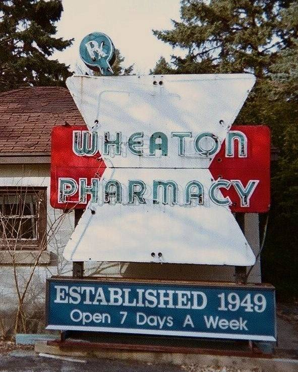 Old Neon Sign Poster featuring the photograph Wheaton Pharmacy by Todd Sherlock