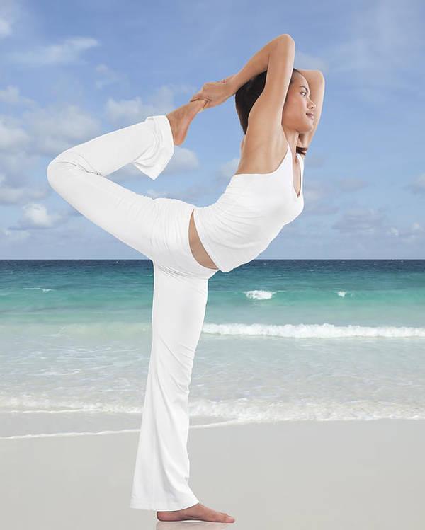 Action Poster featuring the photograph Woman Doing Yoga On The Beach by Setsiri Silapasuwanchai