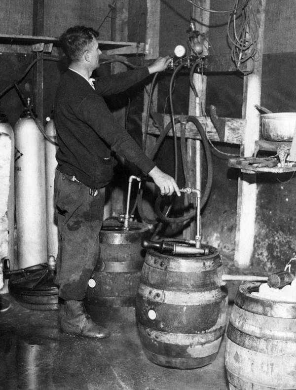 1930s Poster featuring the photograph A Brewmeister Fills Kegs At A Bootleg by Everett