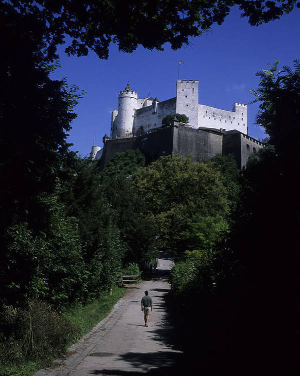 Salzburg Poster featuring the photograph A Man Walks Toward The Salzburg Castle by Taylor S. Kennedy