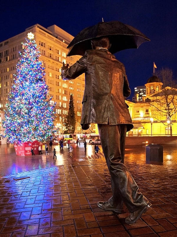 Portland Oregon Downtown Pioneer Square Umbrella Man Allow Me Statue Tree Christmas Time Holiday Dusk Evening Night Courthouse Bricks Wet Pavement December Poster featuring the photograph A Very Portland Christmas by Patrick Campbell