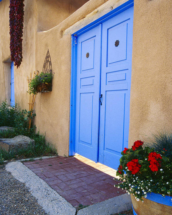 Adobe Poster featuring the photograph Blue Door Of An Adobe Building Taos New Mexico by George Oze