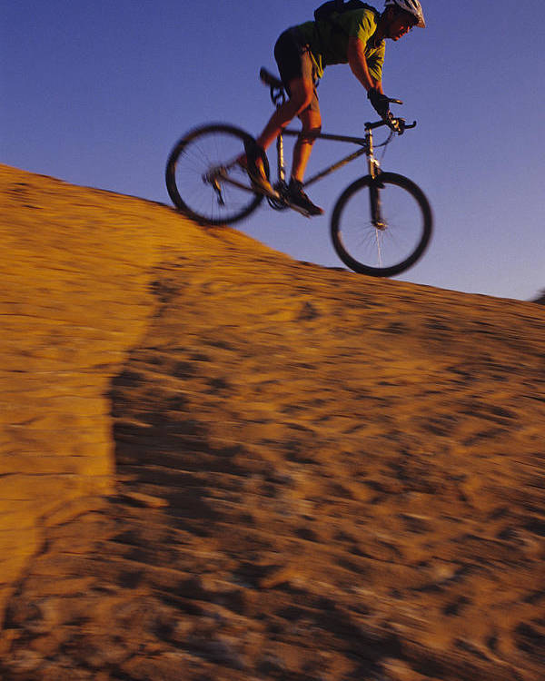 Adventure Sports Poster featuring the photograph Caucasian Male Mountain Biking by Bobby Model