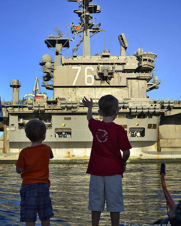 Aircraft Carrier Poster featuring the photograph Children Wave As Uss Ronald Reagan by Stocktrek Images