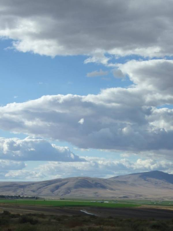 Clouds Poster featuring the photograph Cloudbreaks Over Rattlesnake by Ruth Stromswold
