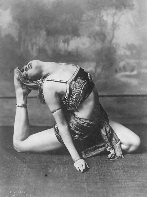 Mid Adult Poster featuring the photograph Contortionist by General Photographic Agency