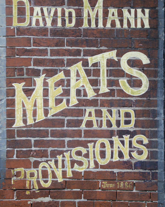 David Poster featuring the photograph David Mann - Meats And Provisions by Bill Cannon