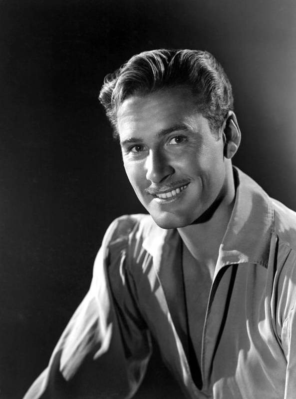 1930s Portraits Poster featuring the photograph Errol Flynn by Everett
