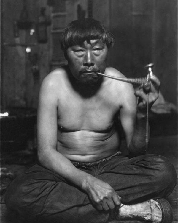 1920s Poster featuring the photograph Eskimo Smoking Pipe, Photograph by Everett