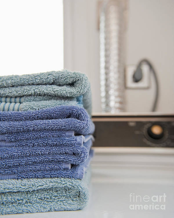 Chores Poster featuring the photograph Folded Towels On A Dryer by Thom Gourley/Flatbread Images, LLC