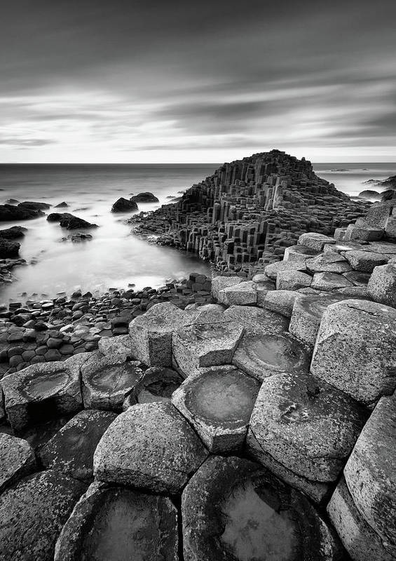 Giants Causeway Poster featuring the photograph Giant's Causeway by Pawel Klarecki