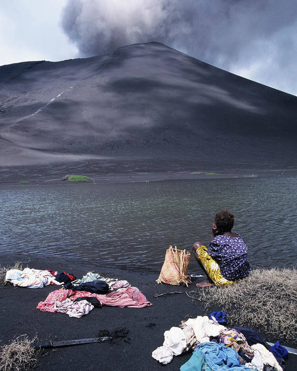 Active Volcano Poster featuring the photograph Girl Washing Clothes In A Lake With The Mount Yasur Volcano Emitting Smoke In The Background by Sami Sarkis