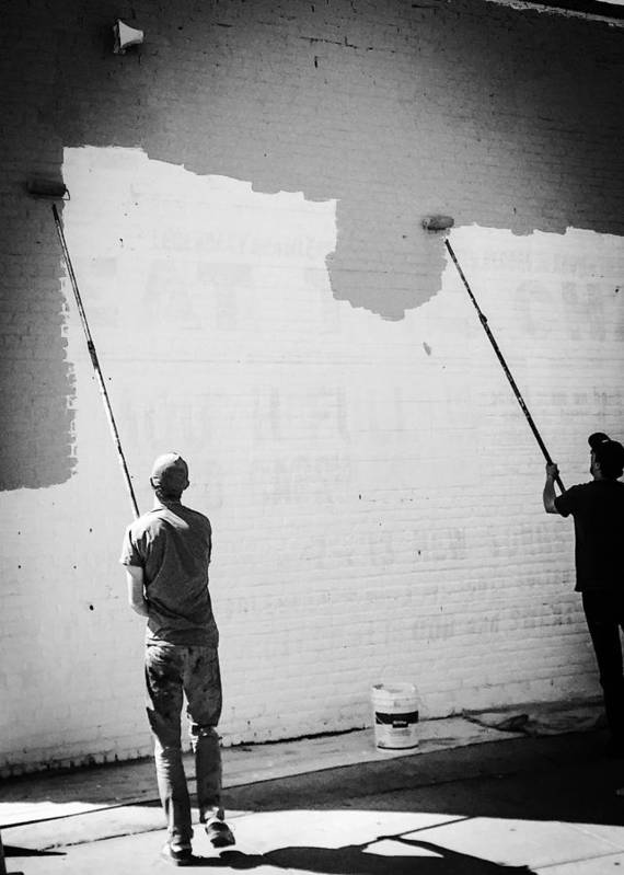 Black And White Poster featuring the photograph Mural Men by Mike Rose