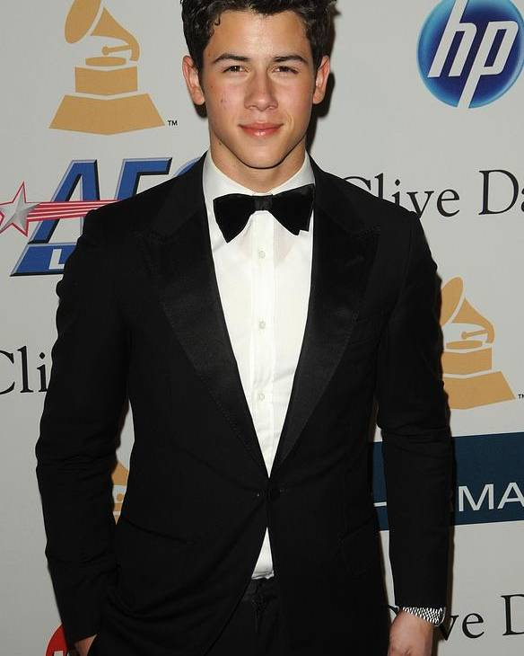 Nick Jonas Poster featuring the photograph Nick Jonas In Attendance For Clive by Everett