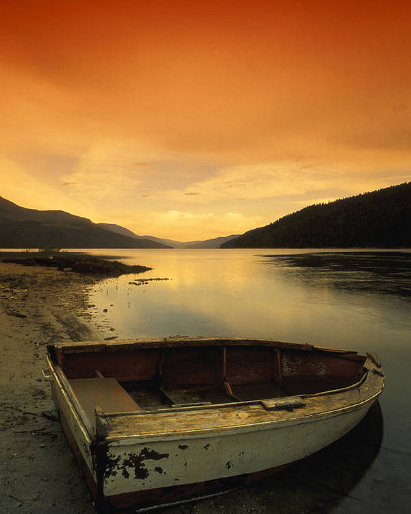 Abandoned Poster featuring the photograph Old Rowboat At Waters Edge With Sunset by Don Hammond