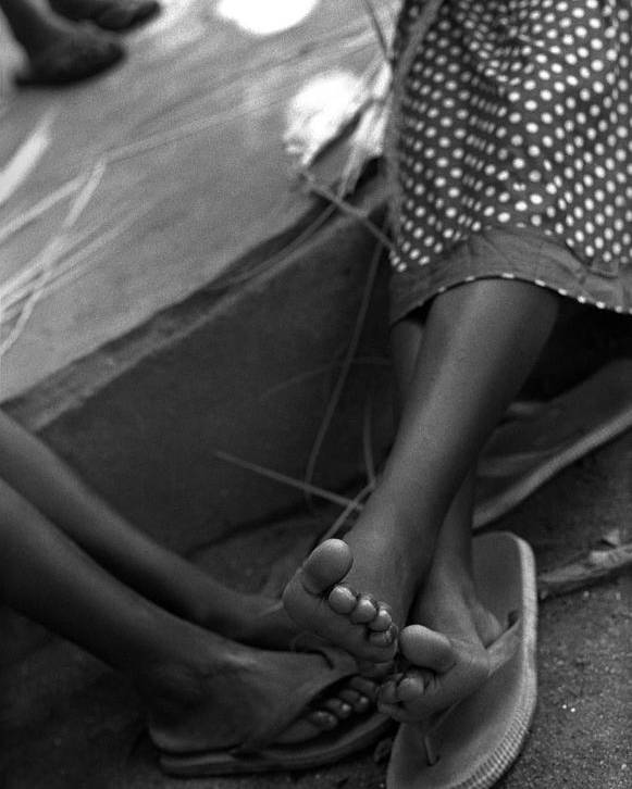 Rwanda Poster featuring the photograph Orphan Feet by Marcus Best