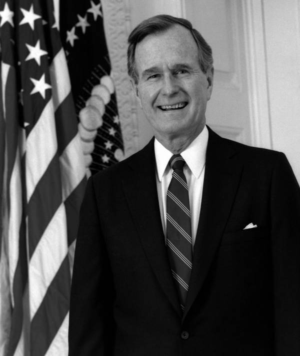 George Bush Poster featuring the photograph President George Bush Sr by War Is Hell Store