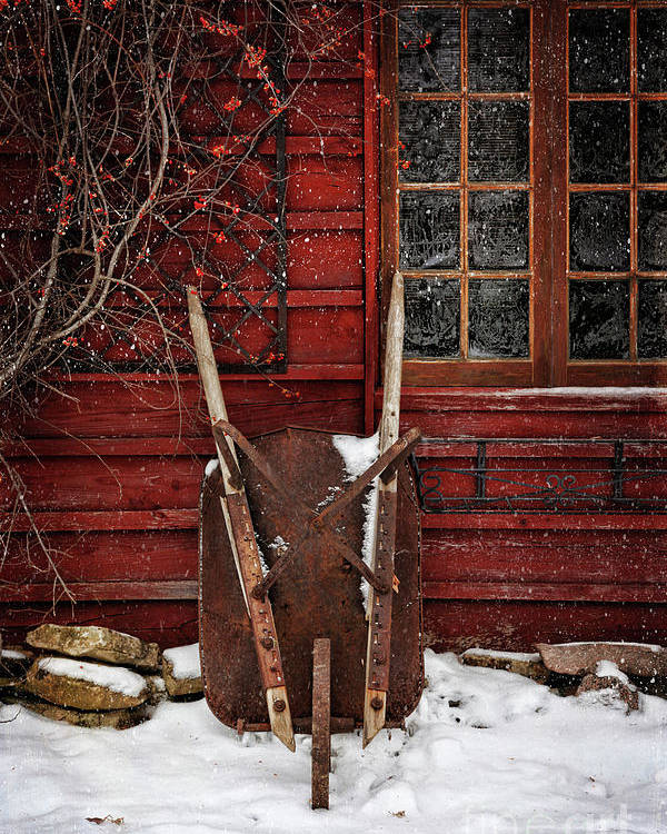 Atmosphere Poster featuring the photograph Rusty Wheelbarrow Leaning Against Barn In Winter by Sandra Cunningham