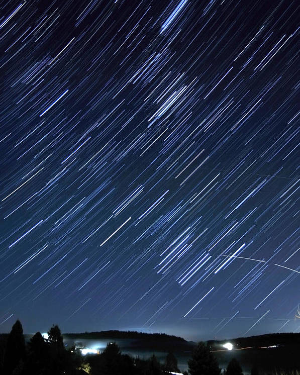 Blue Poster featuring the photograph Star Trails Long Exposure At Night by Evan Sharboneau