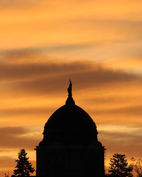 Montana Poster featuring the photograph Sunset Over The Montana Capital by Rob Hoffman