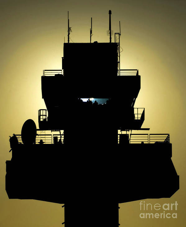 Military Poster featuring the photograph The Setting Sun Silhouettes An Air by Stocktrek Images