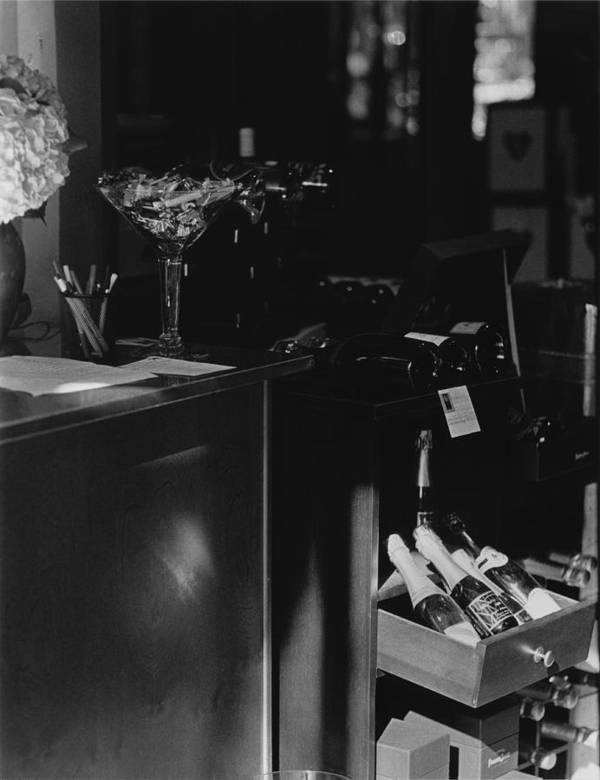 Still Life Poster featuring the photograph Through The Wine Shop Window by Jim Furrer