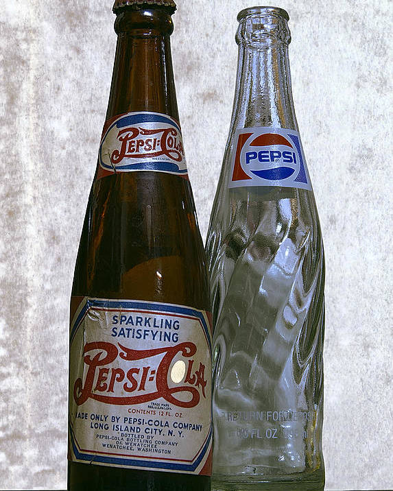 Pepsi Poster featuring the photograph Two Pepsi Bottles On A Table by Daniel Hagerman