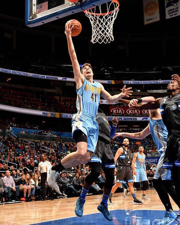 Nba Pro Basketball Poster featuring the photograph Denver Nuggets V Orlando Magic by Fernando Medina